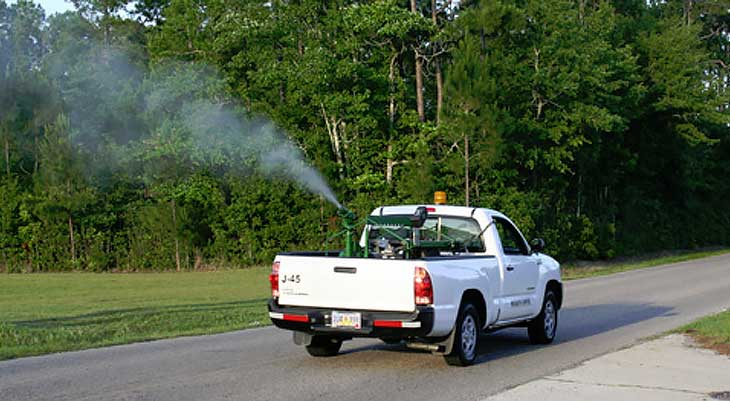 Image of white truck spraying chemicals